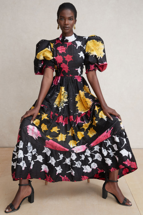 Model wearing Stitch Fix Elevate grantees women's long, colorful black, pink, yellow print dress.
