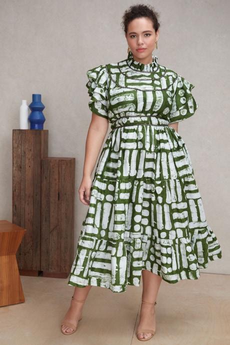 Model wearing Stitch Fix Elevate grantees women's green and white midi print dress.