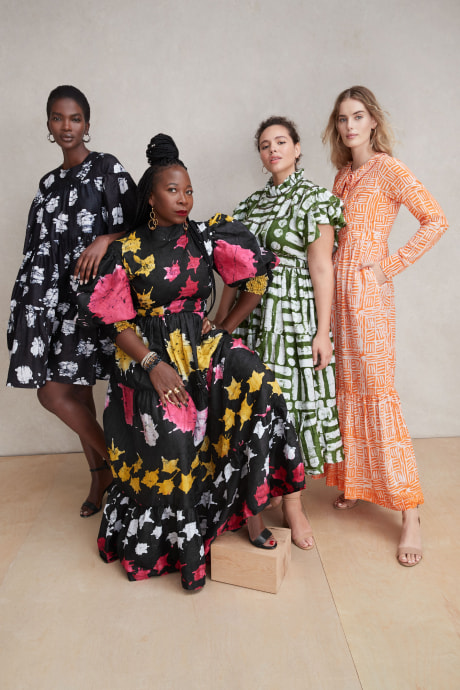 Models and Stitch Fix Elevate grantee wearing multi colored and patterned dresses by Busayo.