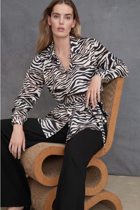 Model wearing Stitch Fix Elevate grantees women's black and white zebra print top.
