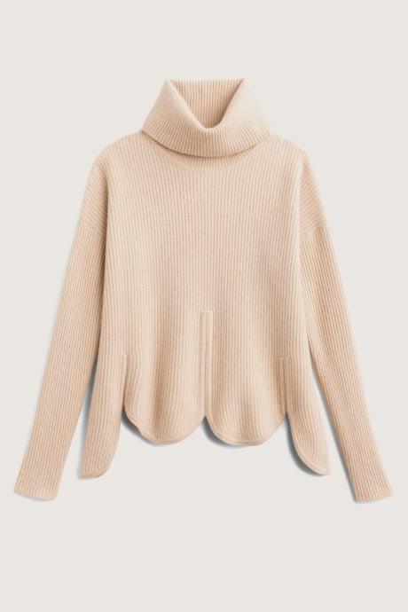 Stitch Fix Elevate grantees women's scalloped-edged cream sweater.