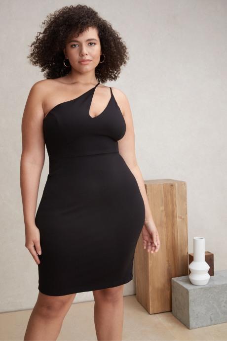 Model wearing Stitch Fix Elevate grantees women's asymmetrical black dress.