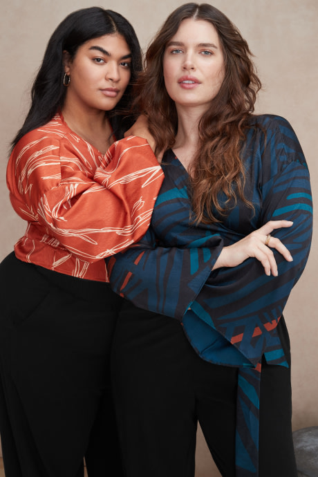 Models wearing Stitch Fix Elevate grantees women's multicolor wrap tops with black pants.
