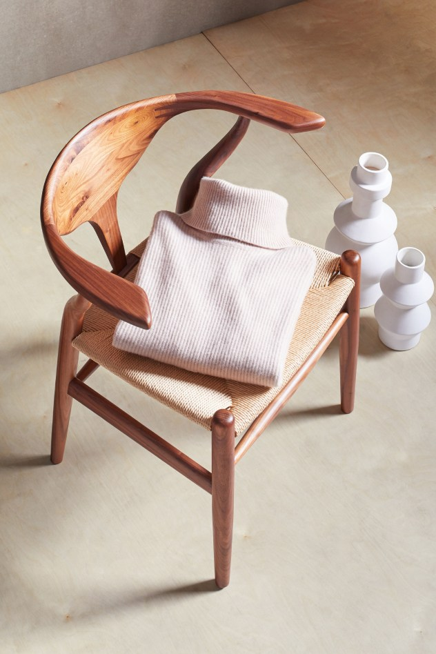 Stitch Fix Elevate grantees women's cream colored turtleneck folded on a chair.