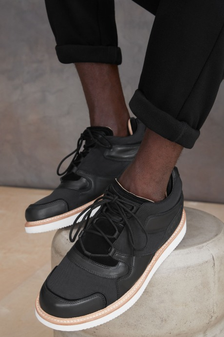 Stitch Fix Elevate grantees men's black nylon and leather shoes.