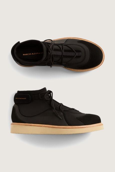 Stitch Fix Elevate grantees men's black shoes with tan soles.