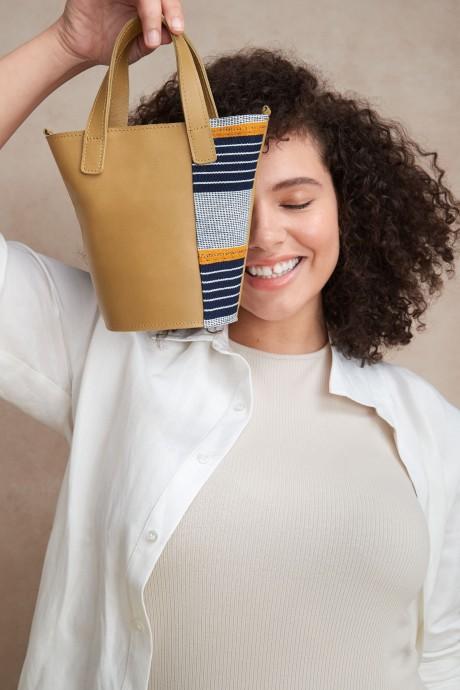 Stitch Fix Elevate grantees women's small yellow handbag with orange and navy stripes.