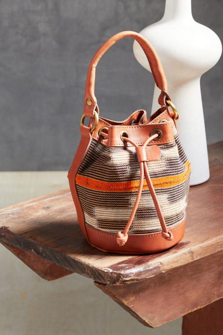 Stitch Fix Elevate grantees women's orange and tan handbag with brown stripes.