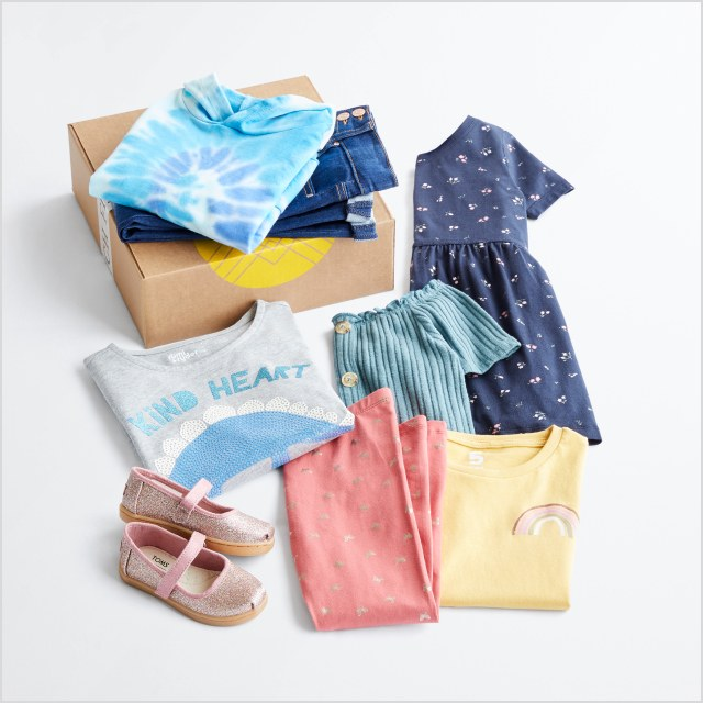 Folded Stitch Fix women's clothes including a grey button shirt, yellow striped tee, tan cardigan, olive pants and shoes.