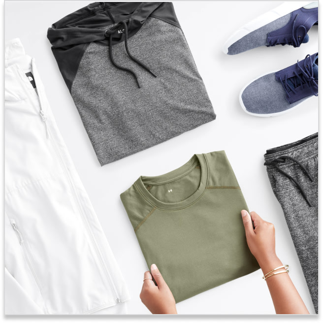 Stitch Fix men's athletic clothes including a grey and black hoodie, green shirt, white jacket, shoes and grey pants.