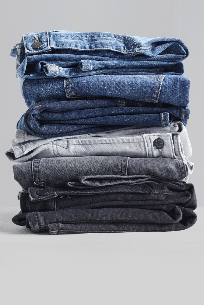 Stitch Fix women's clothes including jeans in a variety of washes.