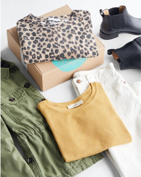 Stitch Fix women's clothes including a sweater, shirt, jacket, jeans and boots.