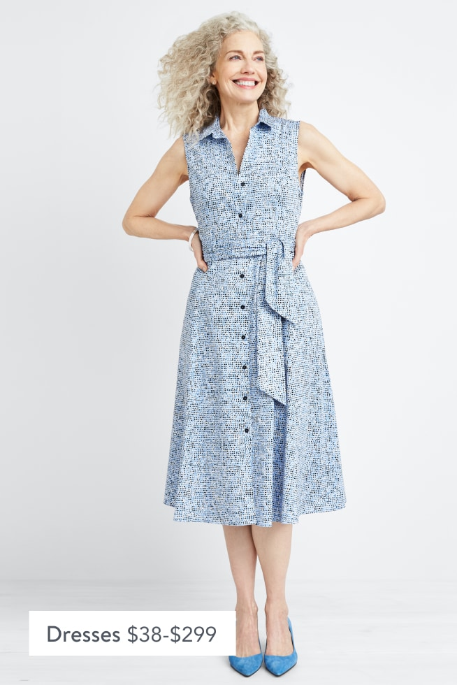 Model wearing Stitch Fix women's clothes including a light blue collared dress and blue shoes.