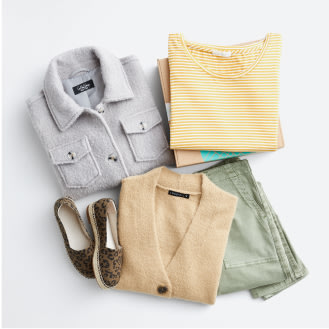 Stitch Fix women's plus-size clothing including a grey button shirt, yellow sweater, tan cardigan, grey pants and shoes.