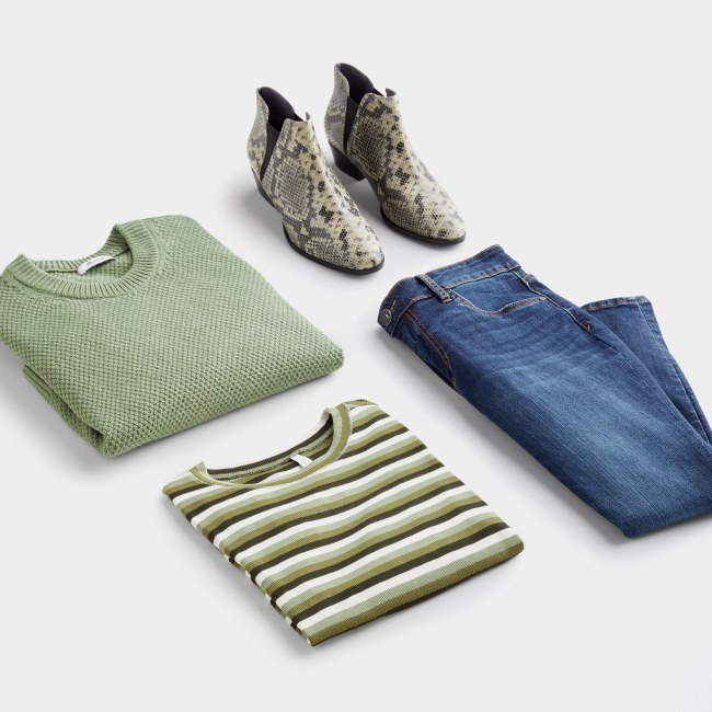 Folded Stitch Fix women's plus-size clothing including a green shirt, jeans, green striped shirt and booties.
