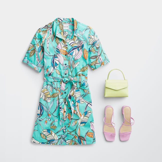 Folded Stitch Fix women's plus-size clothing including green printed dress, yellow handbag and pink shoes.