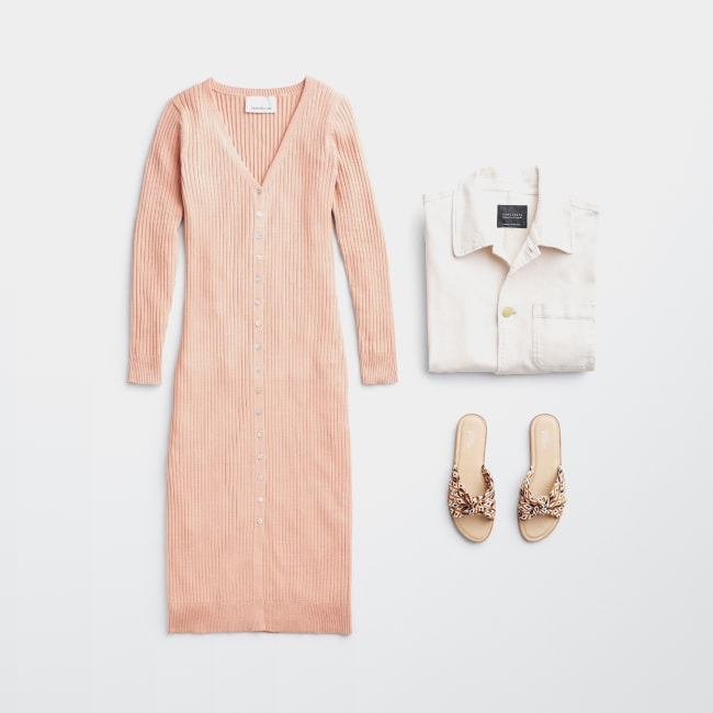 Folded Stitch Fix women's plus-size clothing including peach dress, white collared top and brown shoes.